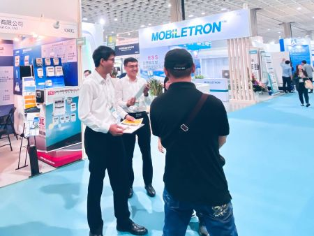 "Representatives of CIC (Challenge Industrial Co., Ltd.) and FLUKE, interacting with a guest at ""2019 Energy Taiwan"" Exhibition"