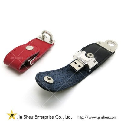 Custom Made Leather USB Flash Drive - A data storage device that includes flash memory with an integrated USB interface.