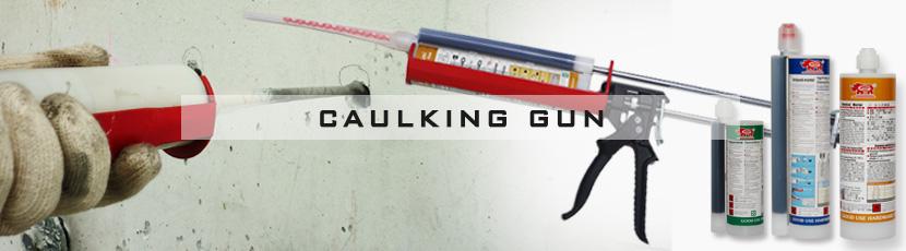 Dual cartridge caulking gun