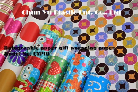 Holographic gift wrapping paper printed with Christmas designs for holiday gifts